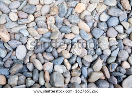 Abstract nature pebbles background. Blue pebbles texture