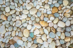 Abstract nature pebbles background. Blue pebbles texture. Stone background. Blue vintage color. Sea pebbles beach. Beautiful nature, zen and inspirational backdrop of garden or spa.