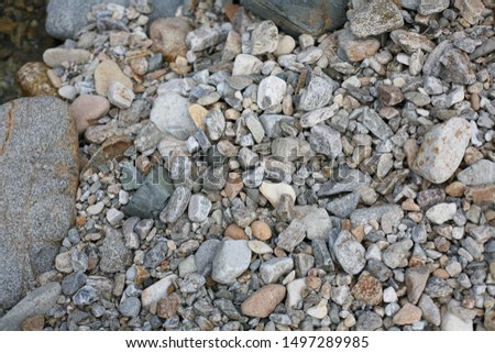 Abstract nature pebbles background. Grey pebbles texture. Stone background. Gravel textures.
