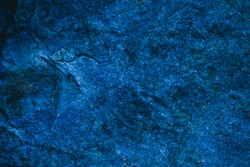 Abstract navy blue texture and background for design. Blue vintage background. Rough blue texture made with stone. Closeup view of abstract deep blue texture.