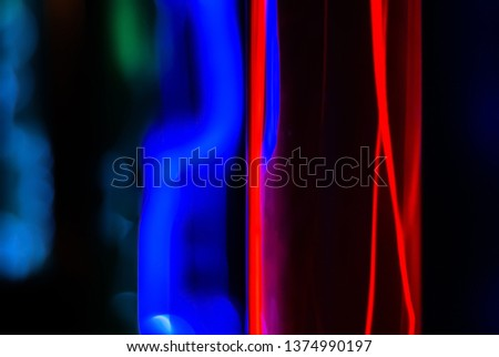 abstract neon background - lightning and blue glowing of electrical discharges in flasks with inert gas on a black background #1374990197