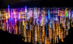 Abstract neon light trail from Hong Kong peak mountain. Concept for busy nightlife, economy, colour, and background.