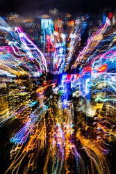 Abstract neon light trail from Hong Kong peak mountain. Concept for busy nightlife, vibrance, colour, and background.