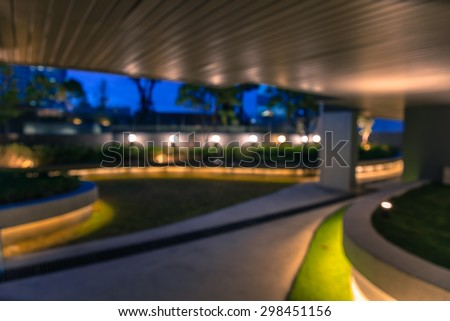 Abstract night garden light bokeh in twilight, defocused background