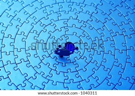 abstract of a blue jigsaw with the last piece upstanding - infrared colors - shallow DOF, focus is on the blue hole