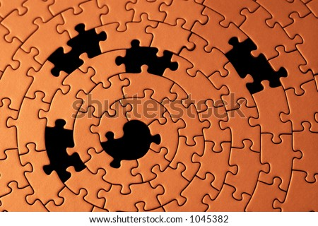 abstract of a jigsaw with five missing pieces - focus is on the center