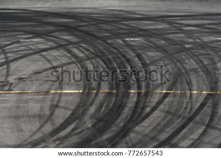 abstract of Black tire wheels caused by Drift car on the road