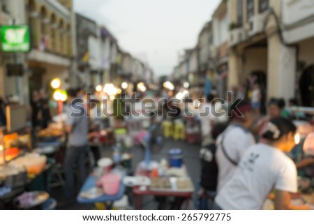 Abstract of blurred people and local food on the street, Phuket, Thailand