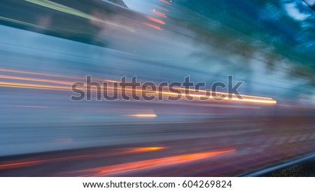 Photo of  abstract of busy traffic under the expressway at night in Bangkok city, Thailand
