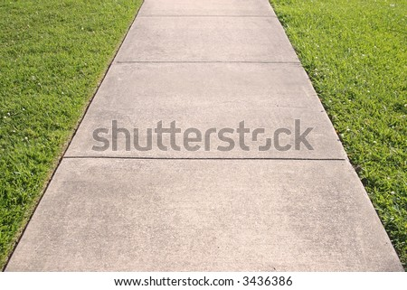 Abstract of concrete sidewalk and grass