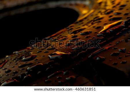 abstract of Dew drops on a tire after rain with the light of sun