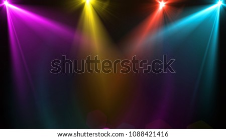 abstract of empty stage with colorful spotlights or Several bright projectors for scene lighting effects . can be used for display or montage your products #1088421416