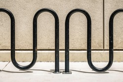Abstract of inverted U bicycle parking rack on college campus