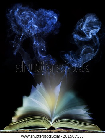 abstract of  open book page with moving smoke on black background use for education and idea creative object