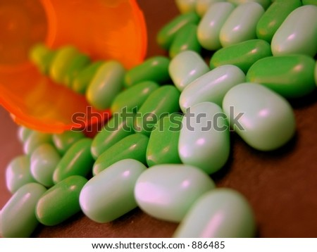 Abstract of Pill bottle with medication spilled out.