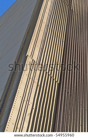 Abstract of portion of Sacramento Tower Bridge of Steel cables over gold painted metal plate