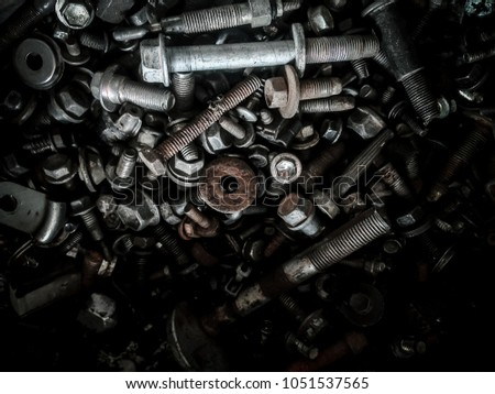 Abstract of Used Metallic for Background of Used old and dirty spare parts wait for get rid or sell to recycle Rusty nuts and bolts background.Dark HDR Grain Tone Style. #1051537565