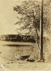 abstract old style photo of countryside pier - forest, lake and boat landscape. black and white image