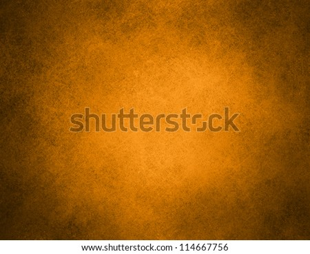 abstract orange background or brown background with bright center background with vintage grunge background texture gradient design or Halloween or warm autumn background invitation or web template