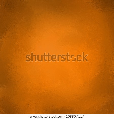 abstract orange background with vintage grunge background texture and black vignette border for thanksgiving or halloween backdrop or autumn and fall brochures