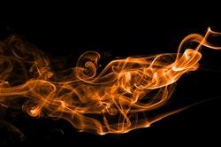 Abstract orange smoke on black background, orange smoke background,orange ink background,orange smoke, beautiful color smoke,movement of orange smoke