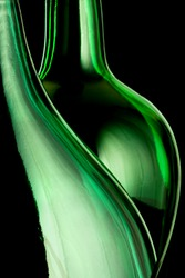 Abstract outlines of two green bottles isolated on black