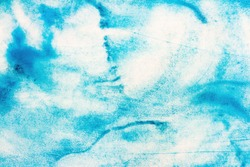 Abstract paint smudges, watercolor fill, background. Seafloor texture. Hand drawn backdrop, streaks of aquarelle paints, blue color with white spots. Beautiful spreads of acrylic paint, wallpaper.
