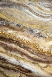 Abstract painting with epoxy resin. Marble streaks of gold,brown and beige . Abstract modern with streaks liquid background for design.