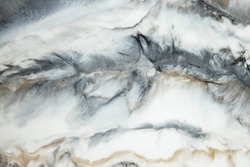 Abstract painting with epoxy resin. Marble streaks of Grey,white and gold. Abstract modern with streaks liquid background for design.