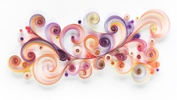 Abstract panel made of colored paper scrolled into curls and rolls. Quilling banner on a white background with copy space. Quilling paper art as a hobby.