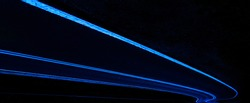 Abstract, panoramic picture of a road in dark colors of black and blue.