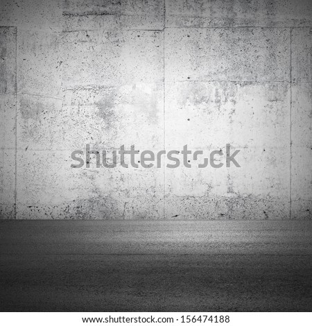 Abstract parking interior fragment with concrete wall and asphalt ground