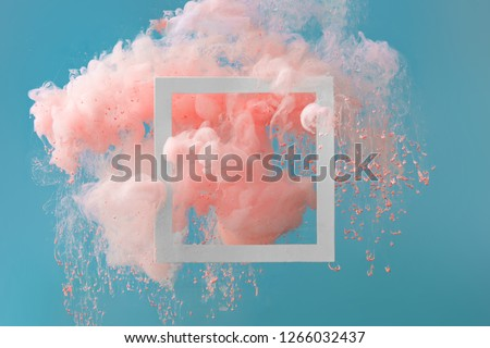 Photo of  Abstract pastel coral pink color paint with pastel blue background. Fluid creative concept composition with copy space. Minimal natural luxury.