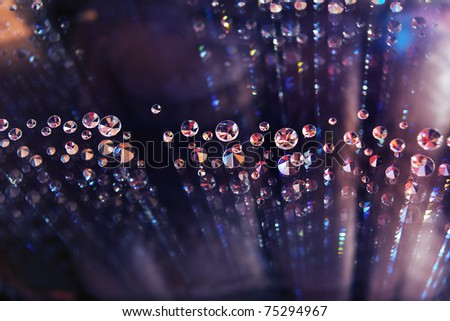 Abstract pattern of many diamonds reflected in glass