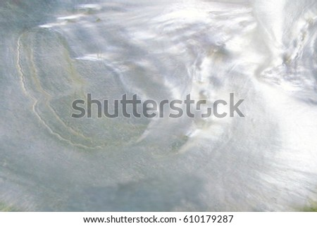 Abstract pearl background with lustrous nacre mother of pearl cloud blur with azure colours
