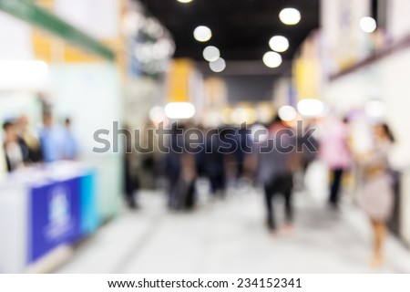 Abstract  people walking in exhibition blurred background