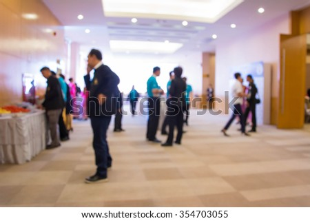 Abstract people walking in exhibition blurred background. #354703055