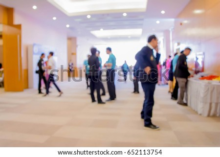 Abstract people walking in exhibition blurred background. #652113754