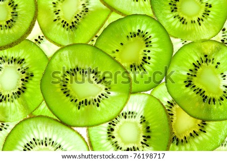 Abstract photo of a green kiwi fruit - stock photo