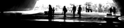 Abstract photo of blurry people going in the underpass. backdrop and design element use. Defocused background with bokeh light.