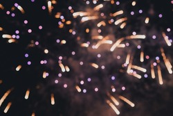 Abstract photo of fireworks. Salute without focus. Blurry photo of fireworks. Festive fireworks. A beautiful flicker of fireworks. Selective focus.