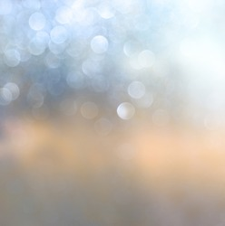 abstract photo of glitter lights background. gold, silver, and white colors . de-focused.