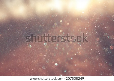 abstract photo of light burst and glitter bokeh. image is blurred and filtered .