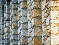 Abstract photo of the back very thick stone wall of a hotel in the Goslar old town