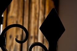 Abstract photography of iron forge fence entrance