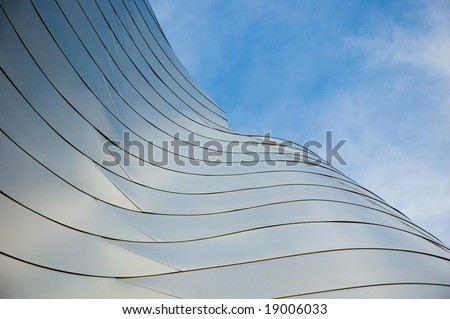 Abstract photos of building wings with blue sky and clouds