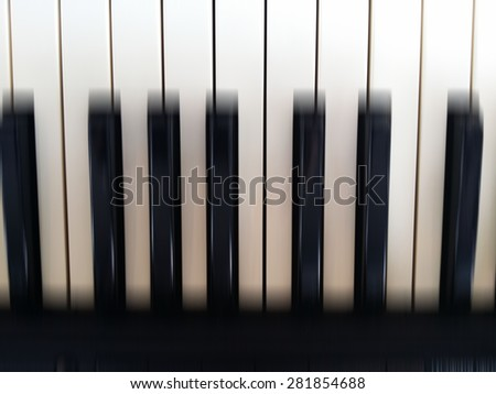Abstract piano keys blur background
