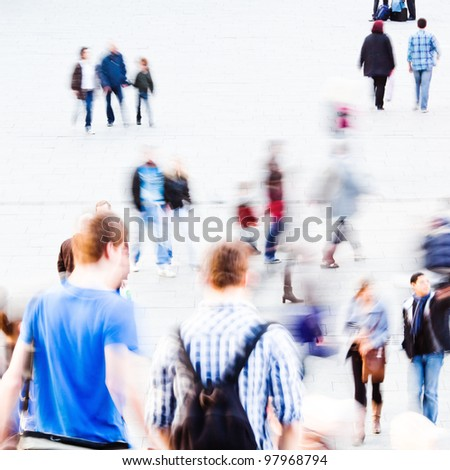 abstract picture of commuting people with motion blur