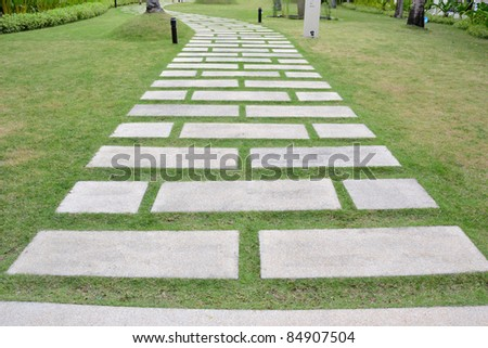abstract picture of nice form of walk path on grass field with blue sky.