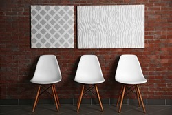 Abstract pictures with chairs on a brick wall background